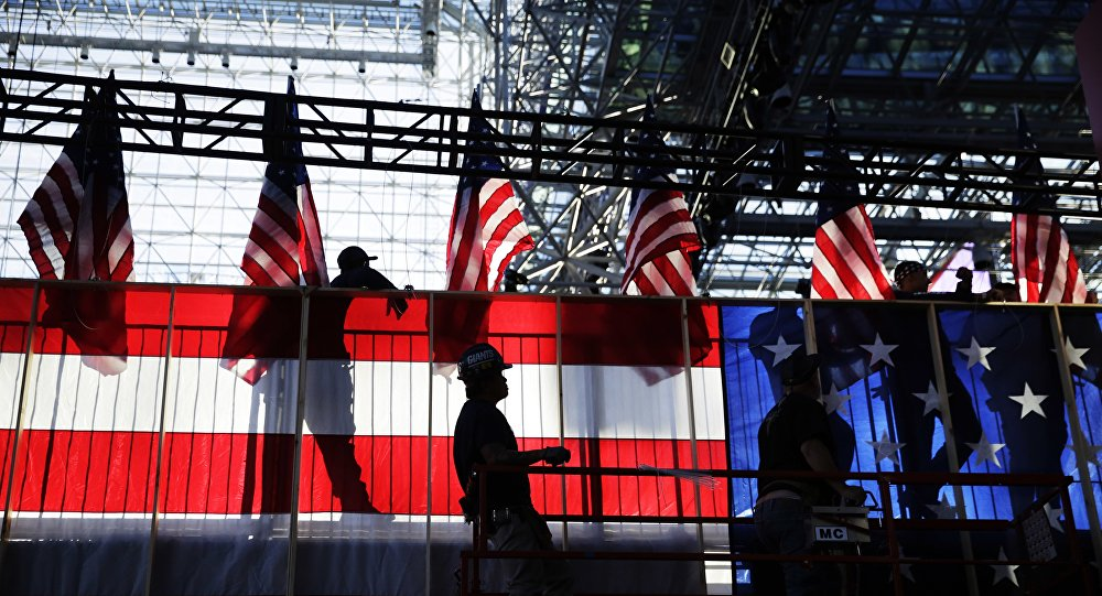 Workers build an American flag to the back of a riser in preparation for Democratic presidential candidate Hillary Clinton's election night rally in New York, Monday, Nov. 7, 2016.