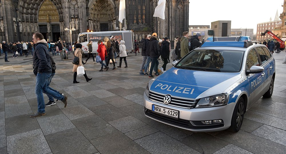 A police car drives past the Cologne Cathedral near the station square on December 30, 2016 in Cologne, western Germany.