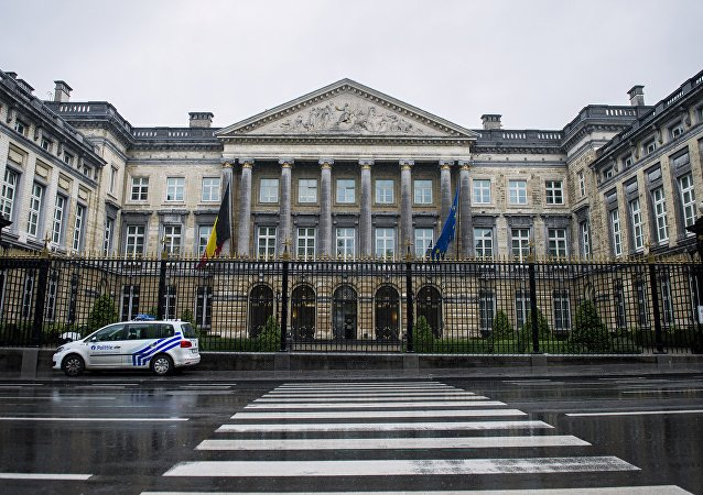 A police car is parked in front of the Belgian Federal Parliament building in Brussels on September 23, 2015 after it was evacuated earlier in the morning due to a bomb alert.
