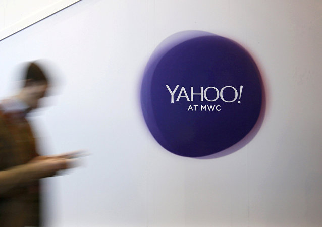 A man walks past a Yahoo logo during the Mobile World Congress in Barcelona, Spain