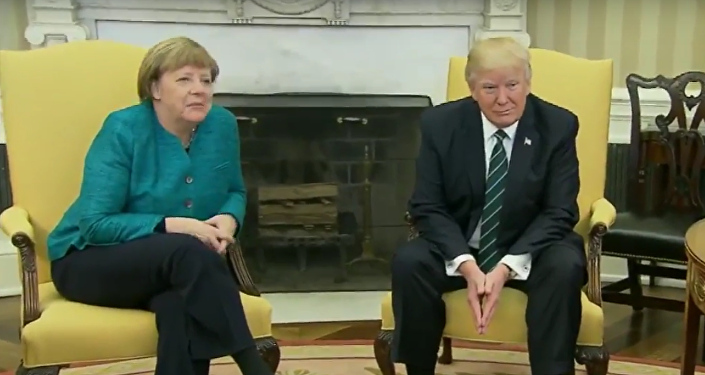 Donald Trump refuses handshake with Angela Merkel