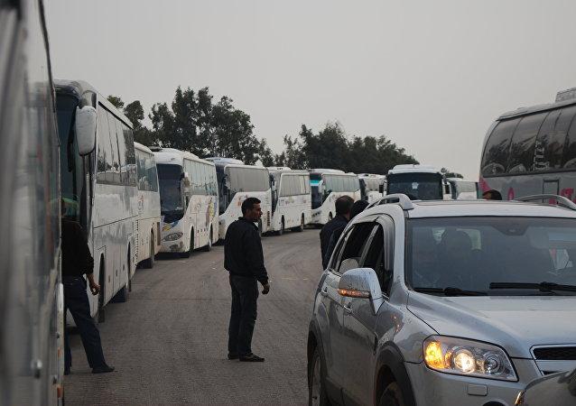Évacuation d'hommes armés de Homs
