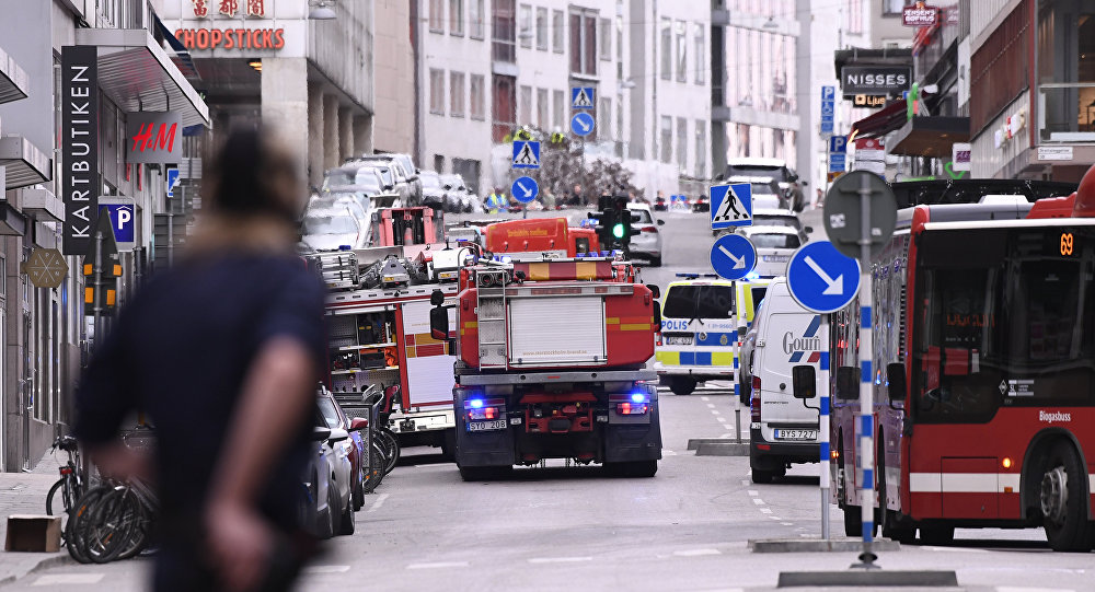 Emergency servies work at the scene where a truck crashed into the Ahlens department store at Drottninggatan in central Stockholm