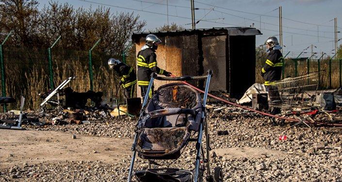 Incendie dans un camp des réfugiés à Grande-Synthe