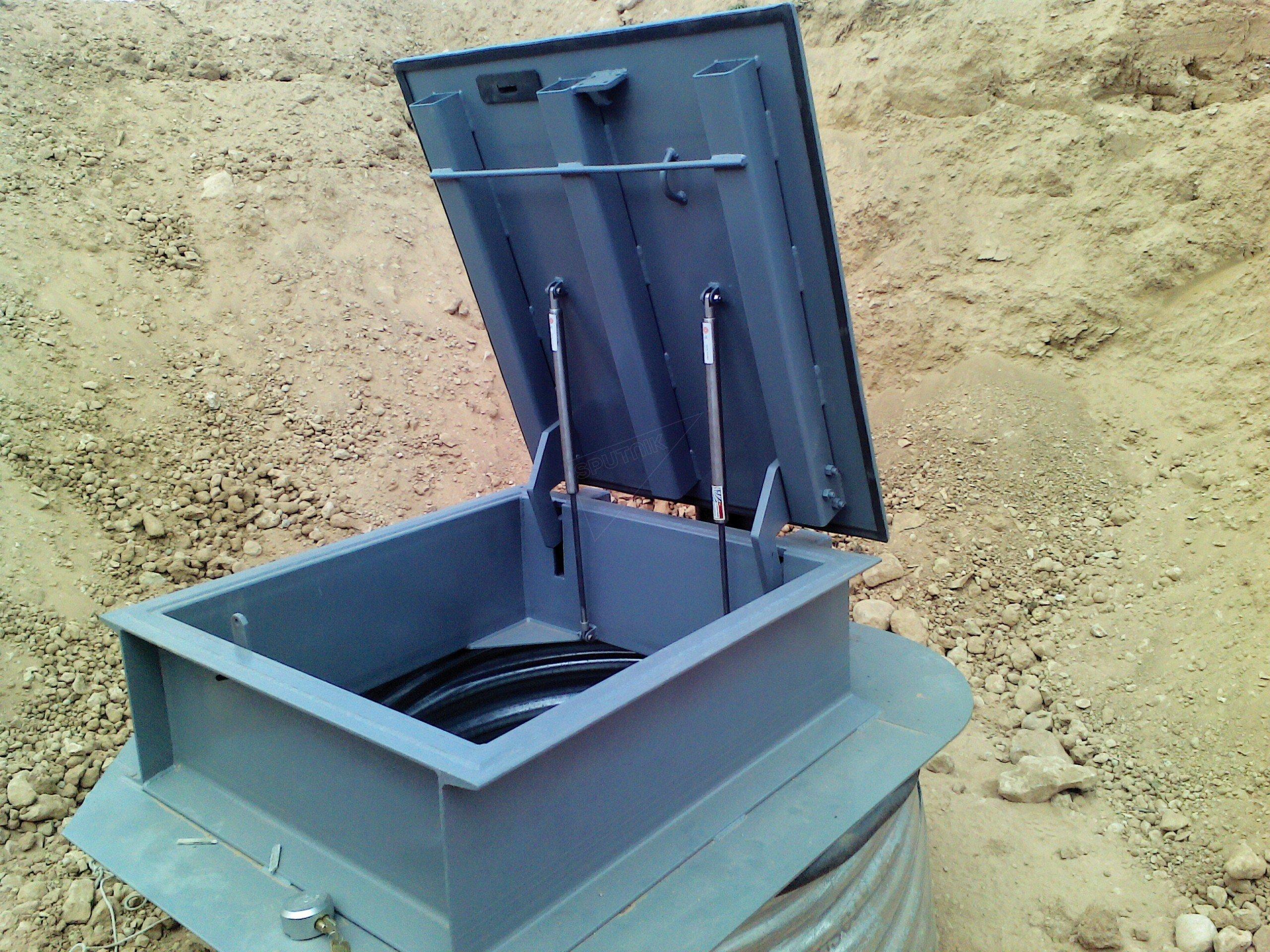 Une trappe préalablement installée qui mènera dans une pièce qui débouchera sur des tunnels