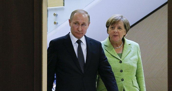Vladimir Poutine et Angela Merkel. Archive photo