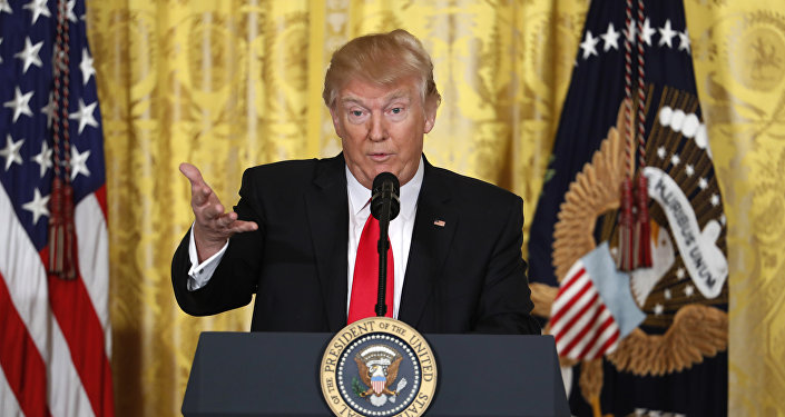 President Donald Trump speaks during a news conference in the East Room of the White House in Washington