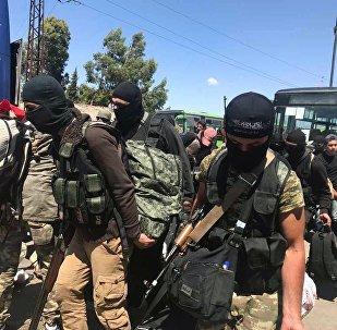 Les derniers hommes armés se retirent de Homs
