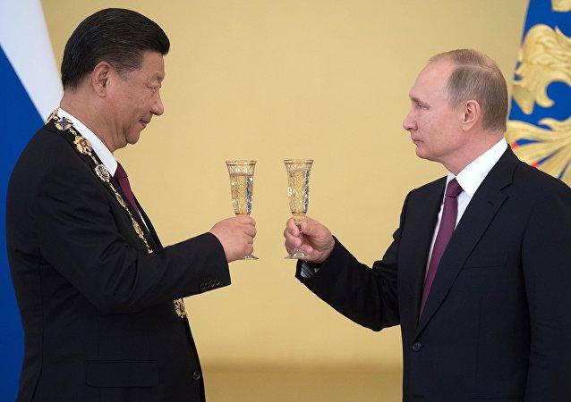 Les Présidents russe et chinois Vladimir Poutine et Xi Jinping