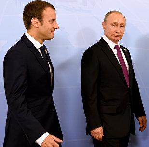 Emmanuel Macron, Wladimir Putin und Angela Merkel bei G20-Gipfel in Hamburg