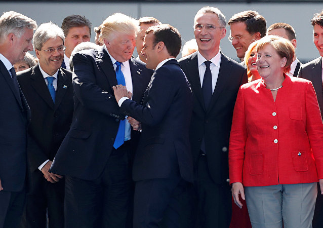 From L-R, Belgium's King Philipe, Italian Prime Minister Paolo Gentiloni, U.S. President Donald Trump who shakes hands with French President Emmanuel Macron, NATO Secretary General Jens Stoltenberg, Dutch Prime Minster Mark Rutte, German Chancellor Angela Merkel, and Canada's Prime Minister Justin Trudeau gather with NATO member leaders to pose for a family picture before the start of their summit in Brussels, Belgium, May 25, 2017
