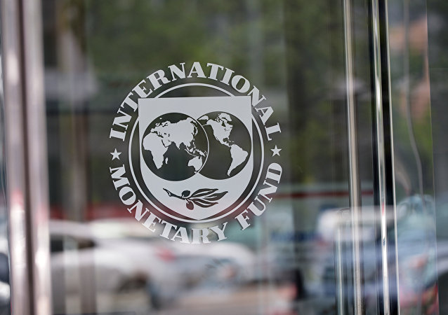 The seal of the International Monetary Fund is seen at the headquarters building in Washington, DC on July 5, 2015