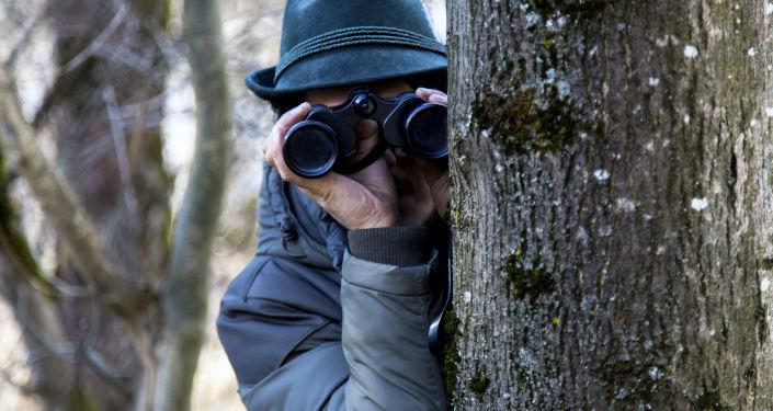 Un espion