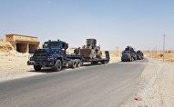 une colonne des forces de l'ordre partie en direction de Tel Afar