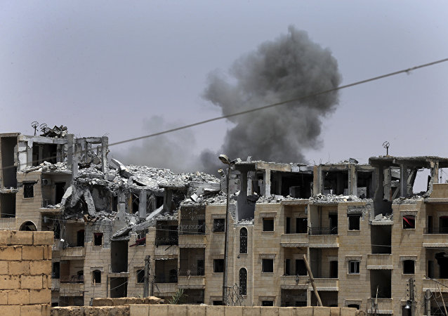 Une ville syrienne après une frappe de la coalition (archive photo)