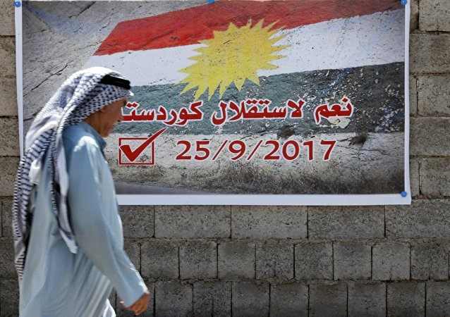 A man passes by a banner that reads Yes for the independence of Kurdistan in Kirkuk, Iraq September 10, 2017.