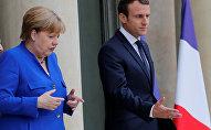 Angela Merkel et Emmanuel Macron. Archive photo