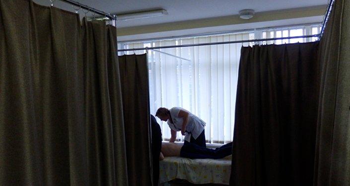 Une séance de massage dans le Centre de sport Évolution