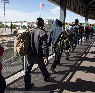 Haitian migrants seeking asylum in the United States, queue at El Chaparral border crossing in the hope of getting an appointment with US migration authorities, in the Mexican border city of Tijuana, in Baja California, on October 7, 2016