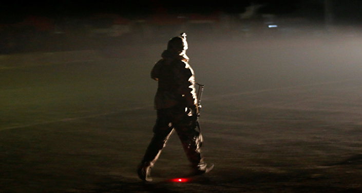 A member of the Afghan security forces arrives the site of an attack on the Intercontinental Hotel in Kabul, Afghanistan January 20, 2018.