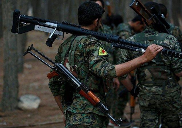 Des membres des Unités kurdes de protection du peuple