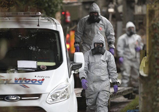 Investigators in protective clothing remove a van from an address in Winterslow, Wiltshire, as part of their investigation into the nerve-agent poisoning of ex-spy Sergei Skripal and his daughter, in England, Monday, March 12, 2018.