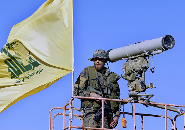 Hezbollah fighter stands at a watchtower (File)