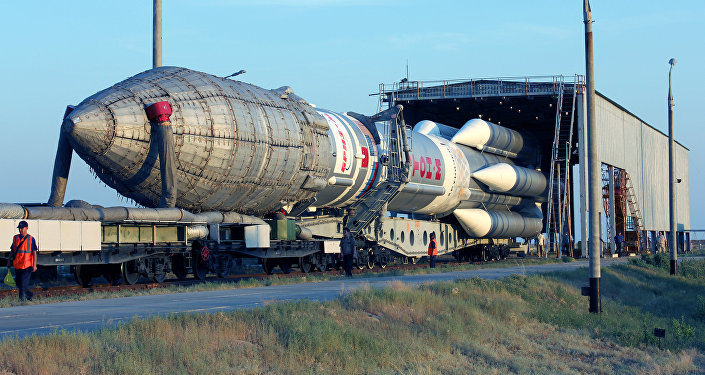 Proton-M space launch vehicle with an upper stage Breeze-M spacecraft and communication Sirius-5 being moved to the launch pad at Baikonur cosmodrome