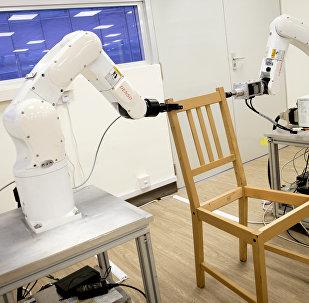 Robots assemble an Ikea chair at Nanyang Technological University (NTU) in Singapore April 17, 2018