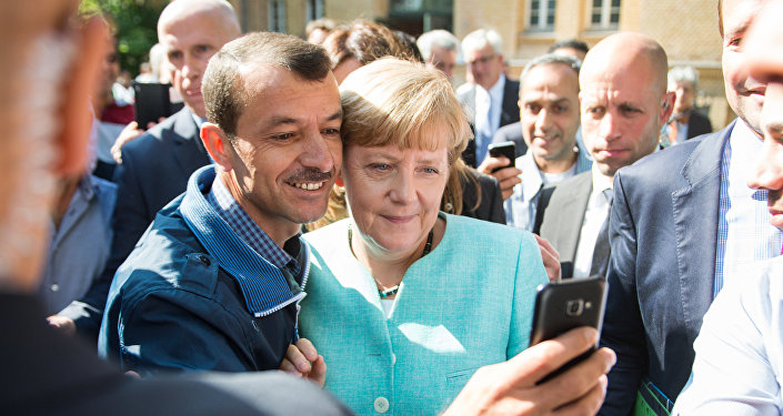 Angela Merkel et un réfugié
