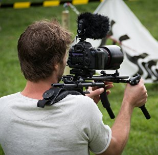 Un caméraman. Image d'illustration