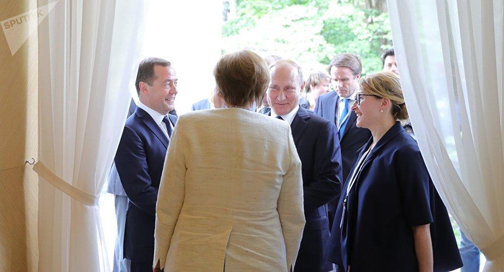 Vladimir Poutine et Merkel