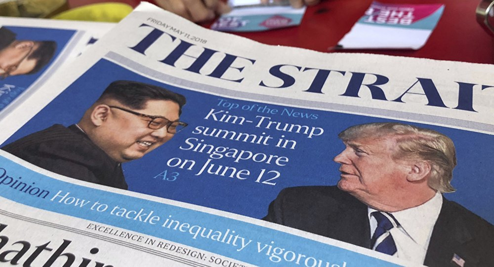 FILE - In this May 11, 2018, file photo, a news vendor counts her money near a stack of newspapers with a photo of U.S. President Donald Trump, right, and North Korea's leader Kim Jong Un on its front page in Singapore.