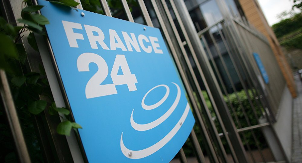 A picture taken on May 3, 2011 in Issy-Les-Moulineaux, a south-western Paris suburb, shows the logo of French International news TV channel France 24 at the headquarters entrance.