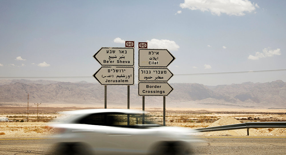 A road sign pointing to the direction of various Israeli cities is seen north to Eilat, Israel, June 12, 2018
