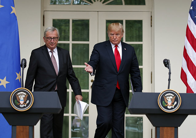 President Donald Trump and European Commission president Jean-Claude Juncker arrive to speak in the Rose Garden of the White House, Wednesday, July 25, 2018, in Washington.