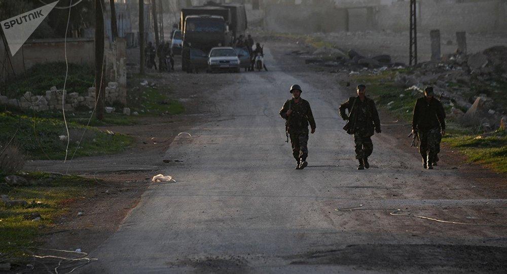 Des militaires syriens dans la province de Hama