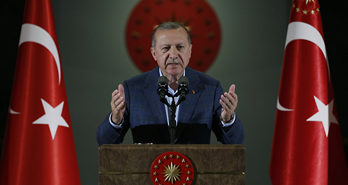 Turkey's President Recep Tayyip Erdogan speaks during an Iftar, the evening meal breaking the Ramadan fast, at his palace in Ankara, Turkey, Saturday, May 19, 2018