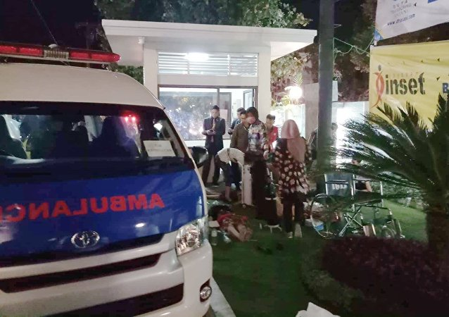 An ambulance is seen near the Golden Palace Hotel after an earthquake hit Lombok Island, Indonesia August 5, 2018, in this picture obtained from social media.