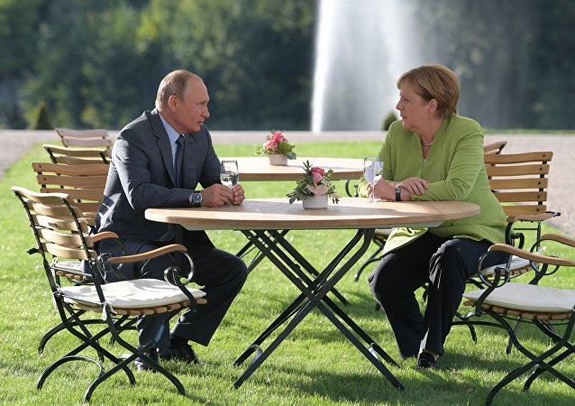 Vladimir Poutine, Angela Merkel