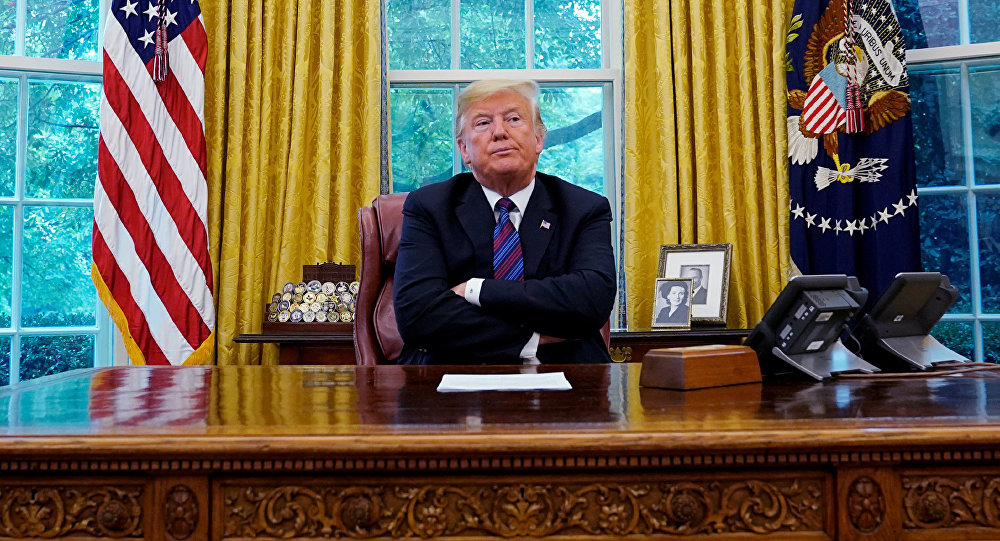 U.S. President Donald Trump sits behind his desk as he announces a bilateral trade agreement with Mexico to replace the North American Free Trade Agreement (NAFTA) at the White House in Washington, U.S., August 27, 2018. REUTERS/Kevin Lamarque