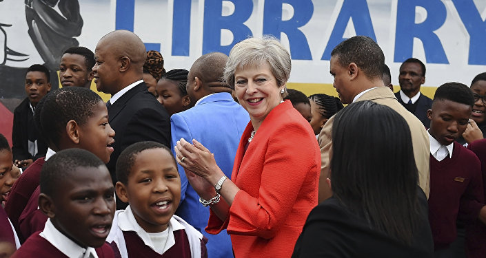 British Prime Minister Theresa May meets pupils during a visit at the the ID Mkhize High School in Gugulethu, Cape Town, South Africa, Tuesday, Aug. 28, 2018. Theresa May has started a three-nation visit to Africa where she is to meet South African President Cyril Ramaphosa