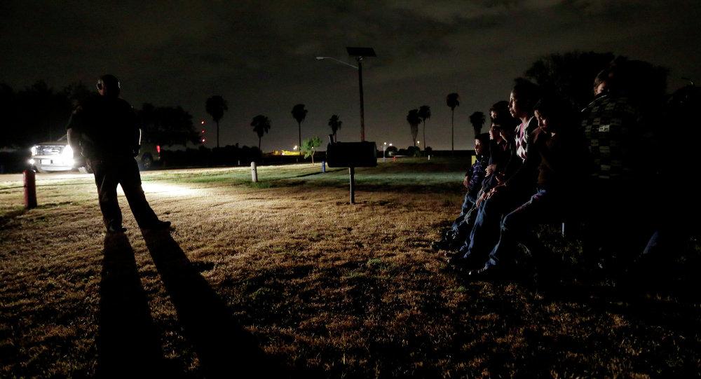 Honduriens à la frontière américano-mexicaine. Photo d'archive