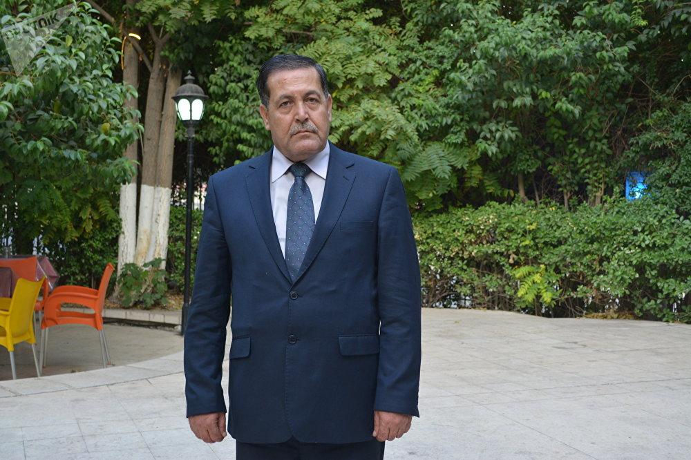 Le général-major Hassan Hassan, responsable de la direction politique de l'armée syrienne
