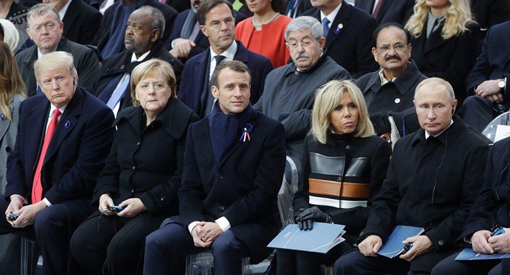Donald Trump, Angela Merkel, Emmnuel Macron, Brigitte Macron y Vladímir Poutine