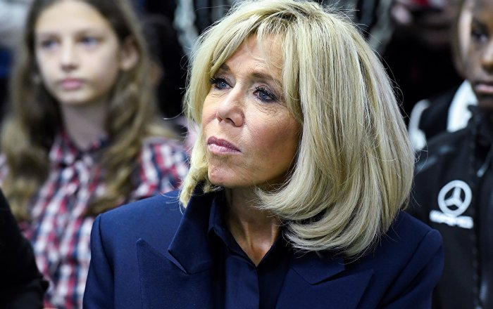 French President's wife Brigitte Macron looks on during a visit to raise awareness about bullying in a high school of Clamart, near Paris, on November 15, 2018.