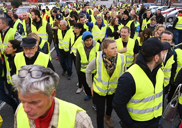 Demonstrator wearing Yellow Vests (Gilets jaunes) protest against the rising of the fuel and oil prices on November 17, 2018on the RN 90 road between Albertville and Chambery, central eastern France.