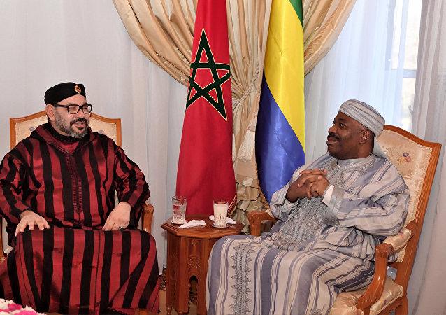Moroccan King Mohammed VI, left, visits Gabonese President Ali Bongo Ondimba