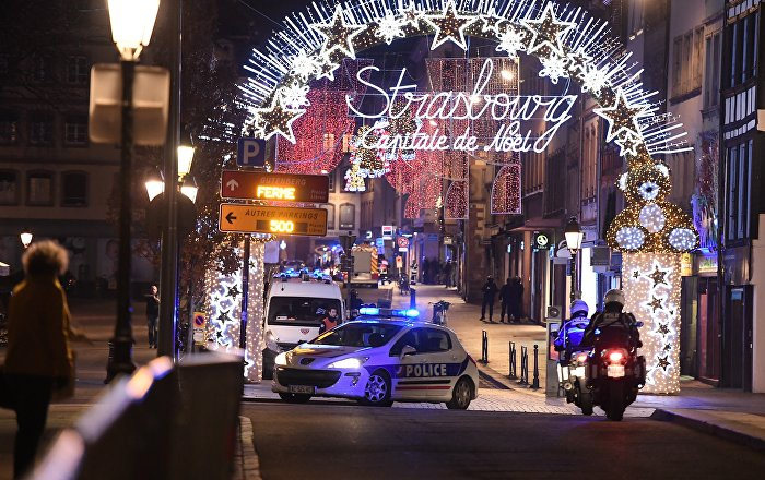 A police car drives in the streets of Strasbourg, eastern France, after a shooting breakout, on December 11, 2018
