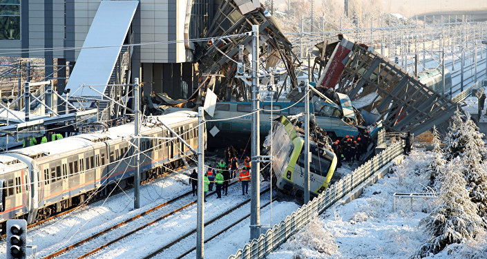 Rescue workers search at the wreckage after a high speed train crash in Ankara, Turkey December 13, 2018